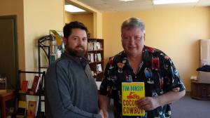 Louisvillian Mark Minteer made sure to strike a pose with the author at Sunday's event.